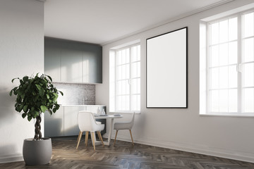 White kitchen with a poster, gray countertops