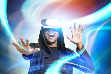 Smiling African guy in VR glasses, abstract