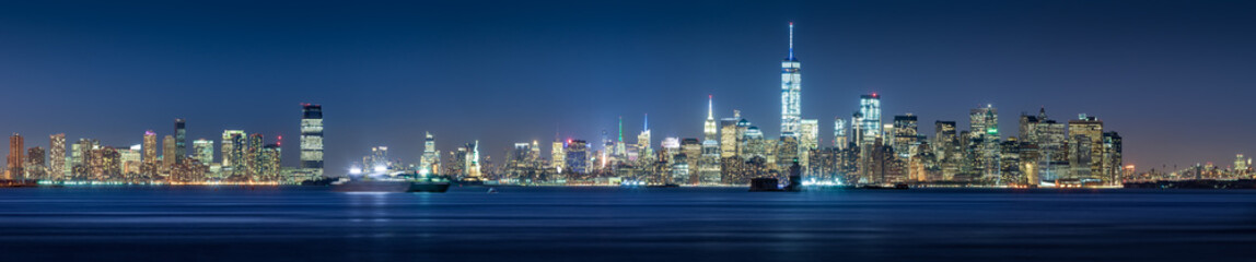 New York City Financial District skyscrapers and Hudson River at dusk. Panoramic view of Lower Manhattan