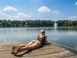 woman lying on plattform and relaxing