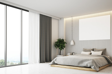 Beige bedroom with a poster, side view