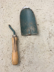 Old and used garden trowel which has broken through years of use