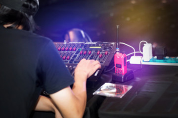 Dj play music at hip hop party.Professional sound mixing controller,digital mixer technology for disc jockey to scratch vinyl records and mix tracks.Music mix