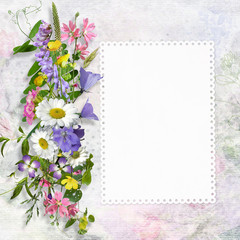 Congratulatory background with a card with space for text or photos and summer flowers