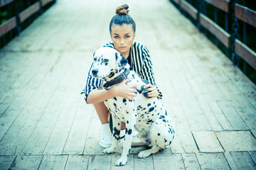 Man's best friend. Woman with dalmatian dog on the bridge posing.