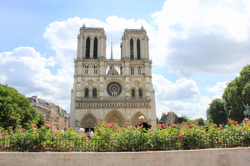 Notre Dame de Paris catholic cathedral in Paris, France. Beautiful french european tourist attraction on bright sunny summer day, cloudy sky copyspace background. Travel sightseeing concept wallpaper