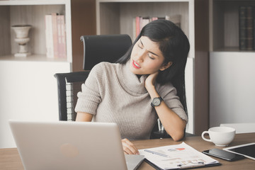 Asian woman working  hard and feeling dizzy at office, woman with office syndrome concept, vintage tone.