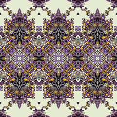 Seamless abstract geometric paisley ornament . Traditional oriental ethnic pattern, lilac and gold tones on pale yellow background. Textile design.