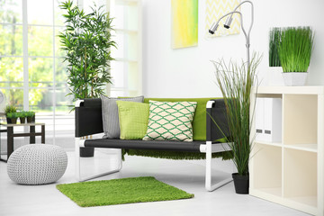 Comfortable living room in white color with green decoration