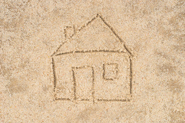 house drawing in sand