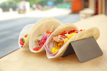Delicious fish tacos in holder outdoor
