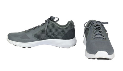 Gray sneakers, front view and side view isolated on white background