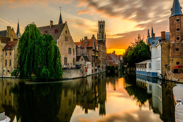 Fotorolgordijn Brugge Bruges (Brugge) cityscape with water canal at sunset