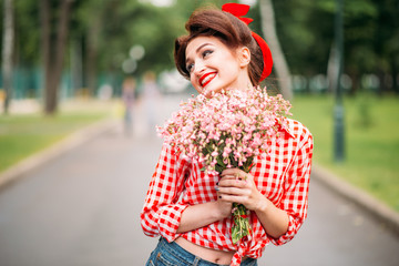 Pinup girl with bouquet of flowers, retro fashion
