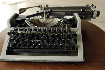 Old black typewriter with round keys