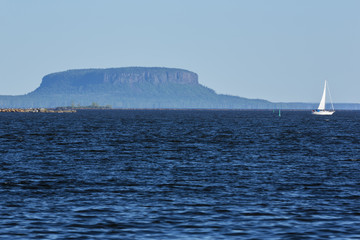 Lake Superior at Thunder Bay with a butte in the background.