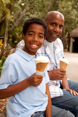 Father and son eating ice cream.
