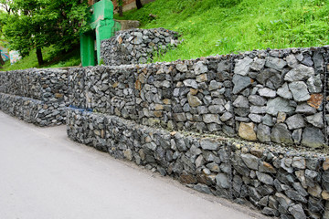 Gabion wall. Metal Cage filled with rocks.
