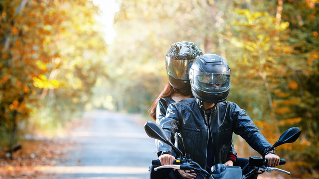 couple biker riding motorcycle