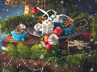 Christmas new year decorations still life on dark wooden background.