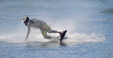 Printed roller blinds Water Motor sports Motosurf Competitor taking corner at speed making a lot of spray.