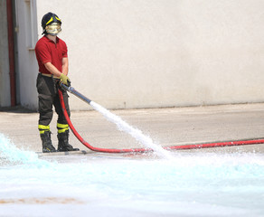 Firefighter with the hydrant mind tests the flow of water during