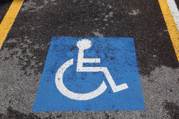 wheelchair symbol in the car parking for disabled people