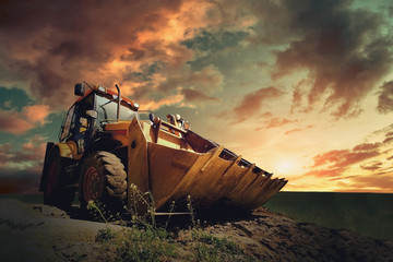 Wall Mural - Yellow tractor on sky background