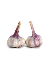 Two heads of young garlic on a clean white background..