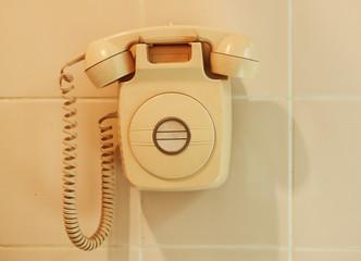 Retro telephone on wall