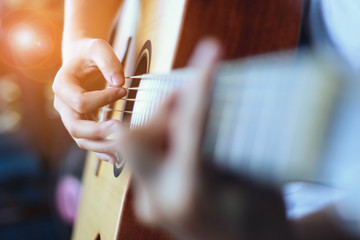 playing guitars lesson. Handsome young men play guitar,selective focus,vintage color