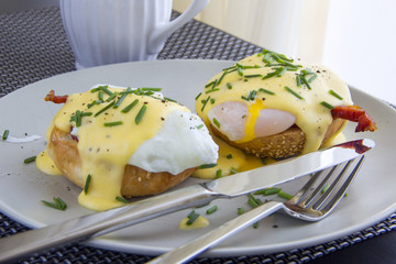 Eggs Benedict. Toasted muffins, ham, poached eggs, and delicious buttery hollandaise sauce
