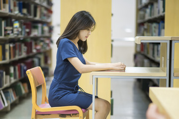 Beautiful women asian university student in library