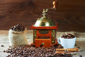 roasted coffee beans and Cinnamon ground in a coffee grinder wooden