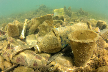 Plastic bottles and other garbage pollution on sea floor