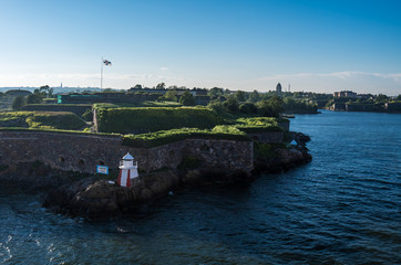 Suomenlinna castle on the island near Helsinki side of the stone fortress and the lighthouse are visible
