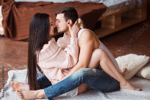 045ae37b Romantic couple. Passion time. Young loving couple embracing and ...