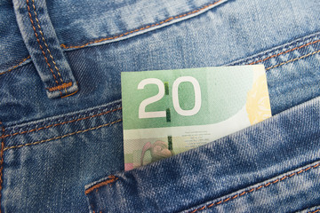 Canadian Dollar in a jeans pocket