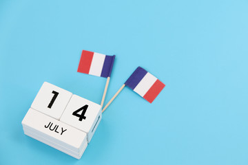 14 july Wooden calendar blue background and French flag,Happy Bastille Day. Concept National Day France,Copy space,minimal style