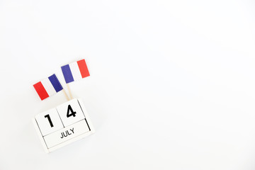14 july Wooden calendar White background and French flag,Happy Bastille Day. Concept National Day France,Copy space,minimal style