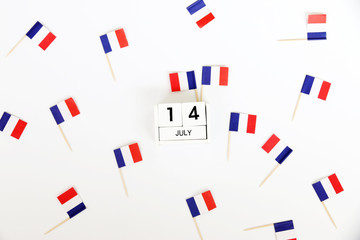 14 july Wooden calendar and Happy Bastille Day. Concept National Day France,minimal style