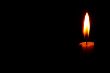 isolated Burning Candle In The Dark