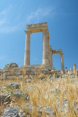 Ruins of an ancient Greek temple of Athena Lindia on Lindos Acropolis. Dodecanese Islands, Greek Islands, Greece, Europe
