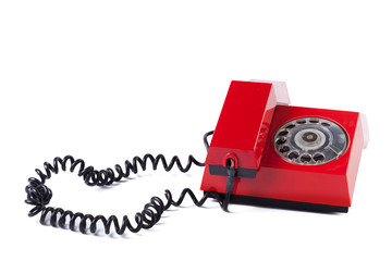 Red old telephone on white background