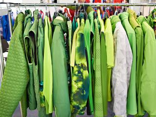 Jackets, waistcoats and rainwear on hanger in store