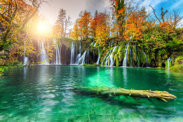 Wall Mural - Colorful aututmn landscape with waterfalls in Plitvice National Park, Croatia
