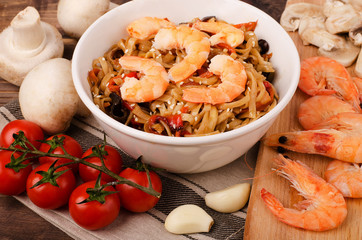 Chinese noodles with shrimp and vegetables in soy sauce