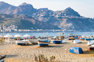 ships on beach in old port in Giardini Naxos town