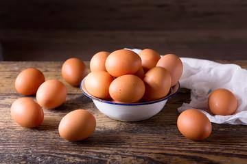 fresh brown eggs in a bowl