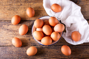fresh brown eggs in a bowl